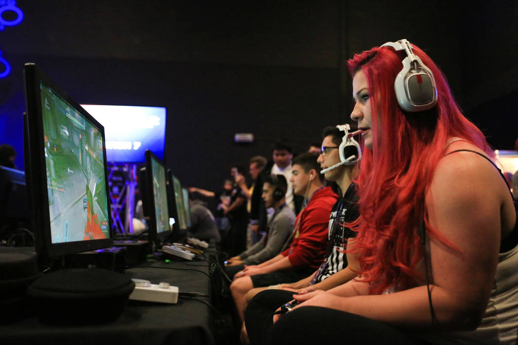 """Ashlee """"Killing In Pink"""" Norman, who plays for Hydra Gaming, warms up before the first set of games of the Halo World Championship North American Qualifier at thE Arena in downto ..."""