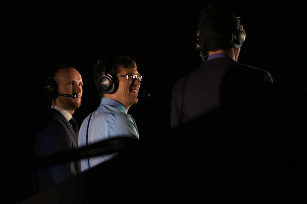 Casters talk amongst themselves after the first game of the Halo World Championship North American Qualifier at thE Arena in downtown Las Vegas on Friday, March 3, 2017, in Las Vegas. (Brett Le Bl ...