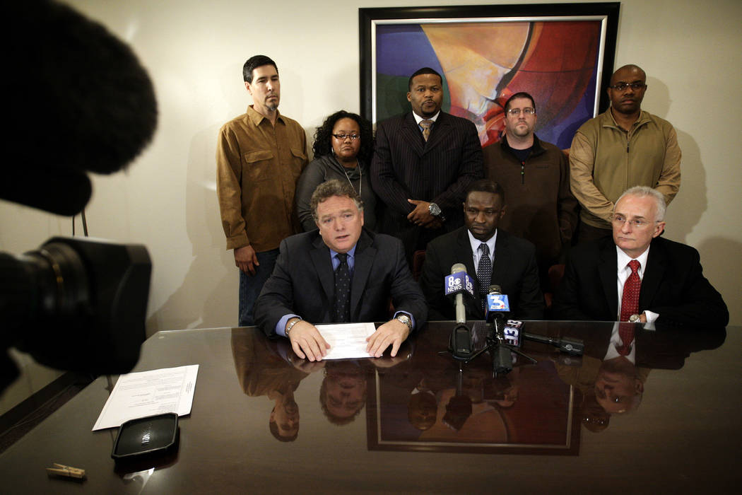 From front left, attorney E. Brent Bryson, Victor Fakoya, and attorney Barney Ales gather for a press conference with friends of Fakoya, top, to announce a federal civil lawsuit against Clark Coun ...