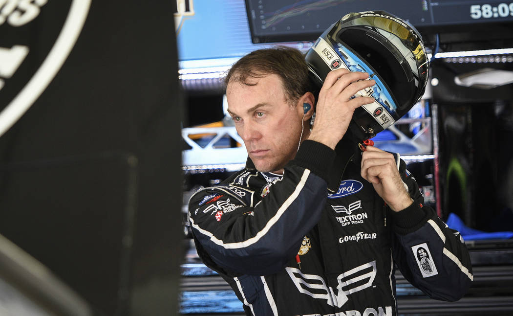 Pole winner Kevin Harvick takes his helmet off in the garage during practice for the NASCAR Monster Cup series auto race at Atlanta Motor Speedway in Hampton, Ga., Saturday, March 4, 2017. (AP Pho ...