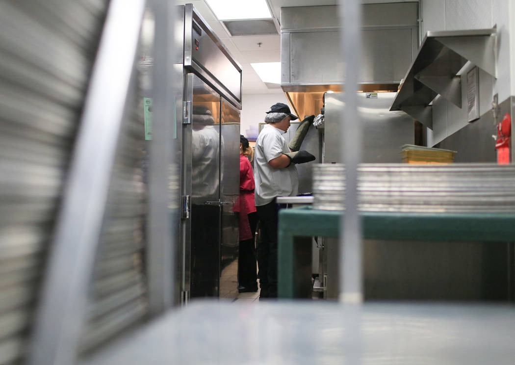 Connor Miranda, 19, opens an oven in the kitchen at the Heritage Park Senior Facility in Henderson on Thursday, March 2, 2017. (Brett Le Blanc/View) @bleblancphoto