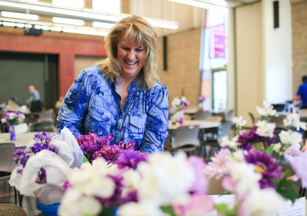 Holly Hoffman, 55, with Touching Hearts at Home, arranges table centerpieces just before lunch at the Heritage Park Senior Facility in Henderson on Thursday, March 2, 2017. (Brett Le Blanc/View) @ ...