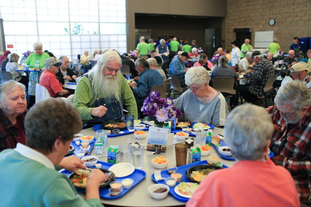Micha Grillett, 70, center left, eats food at his usual table at the Heritage Park Senior Facility in Henderson on Thursday, March 2, 2017. (Brett Le Blanc/View) @bleblancphoto
