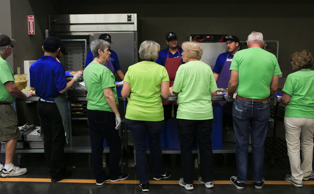 Volunteers wait for food to be put onto trays during a back up at the Heritage Park Senior Facility in Henderson on Thursday, March 2, 2017. (Brett Le Blanc/View) @bleblancphoto