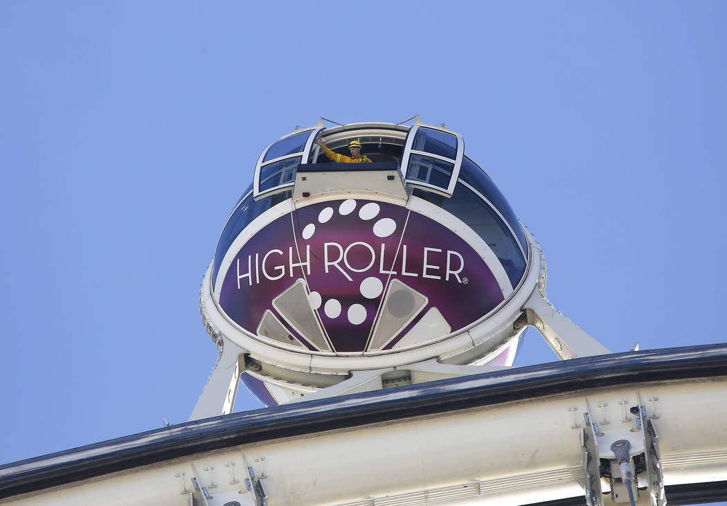 A Las Vegas Valley firefighter opens the door of a pod on The High Roller Observation Wheel as they practice rescue scenarios on Tuesday, March 7, 2017, in Las Vegas. (Christian K. Lee/Las Vegas R ...