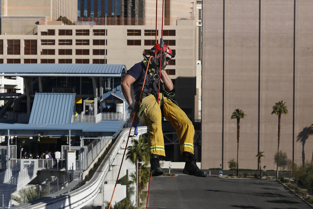 A Las Vegas Valley firefighter repels from the top of The High Roller Observation Wheel on Tuesday, March 7, 2017, in Las Vegas. (Christian K. Lee/Las Vegas Review-Journal) @chrisklee_jpeg