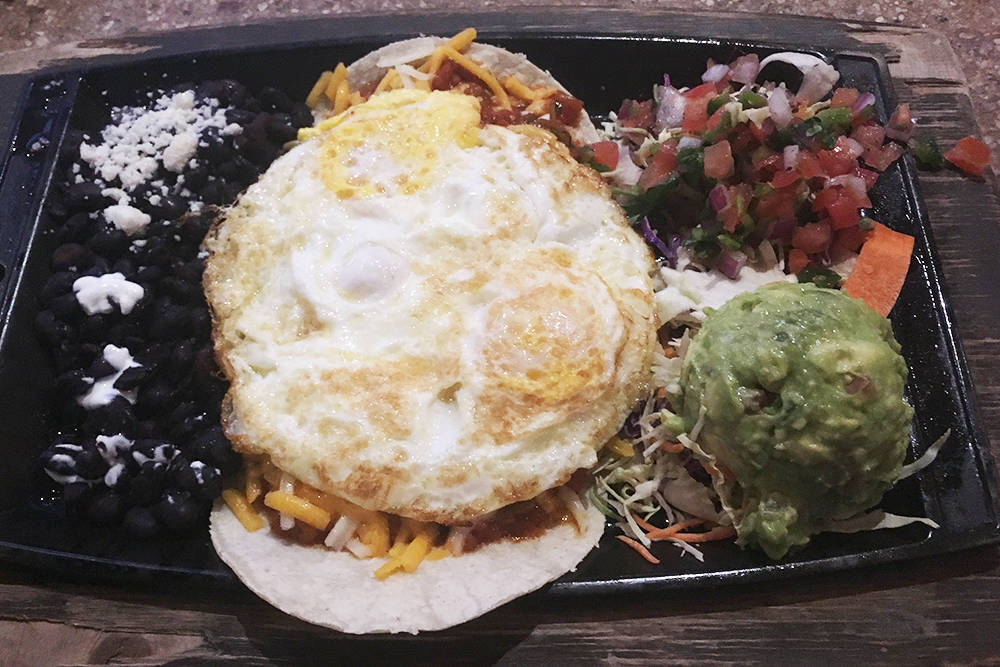 Huevos rancheros were among the healthier dishes on the menu and cost about $11. (Brian Sandford/View @nweditor)