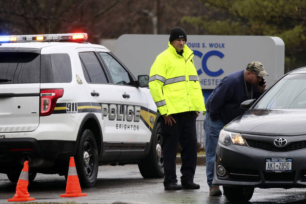 Police officers investigate a bomb threat outside the Louis S. Wolk Jewish Community Center of Greater Rochester in Brighton, N.Y on Tuesday, March 7, 2017. (Tina Macintyre-Yee/Democrat & Chro ...