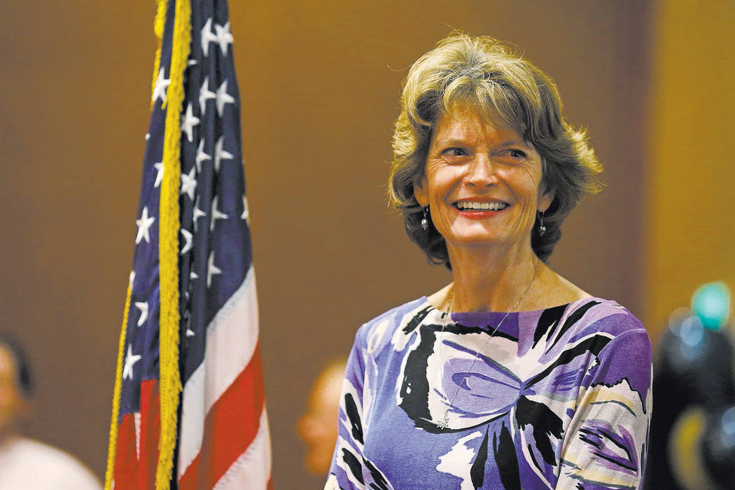 U.S. Sen. Lisa Murkowski, R-Alaska stands on stage at an election-night rally for Republican U.S. Senate candidate Dan Sullivan, Tuesday, Nov. 4, 2014, in Anchorage Alaska. Sullivan is challenging ...