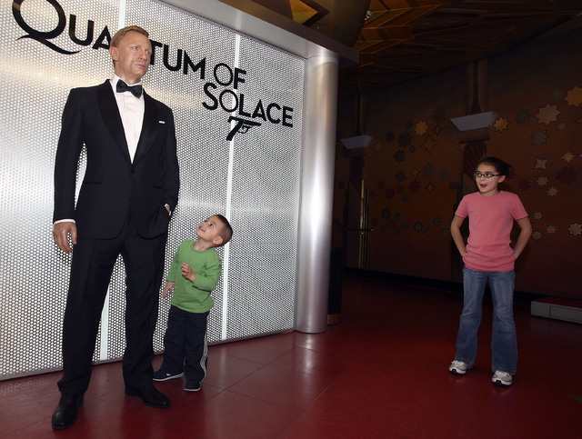 A wax figure of actor Daniel Craig in his James Bond 007 persona seems to intrigue three-year-old Gavin Schiavone as he visits Madame Tussaud's wax museum inside The Venetian hotel-casino in Las V ...