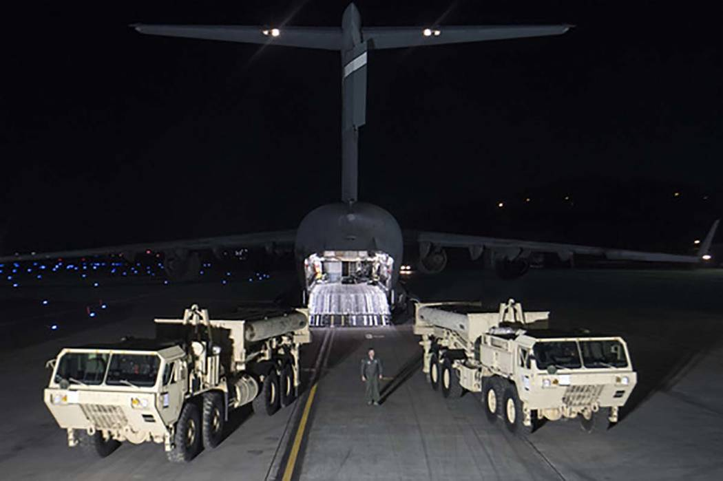 In this photo provided by U.S. Forces Korea, trucks carrying parts of U.S. missile launchers and other equipment needed to set up Terminal High Altitude Area Defense (THAAD)  missile defense syste ...