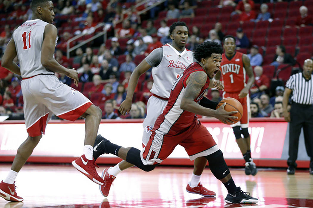 UNLV Rebels guard Jovan Mooring (30) drives to the hoop against the Fresno State Bulldogs in the second half at the Save Mart Center. The Bulldogs defeated the Rebels 72-59. (Cary Edmondson-USA TO ...