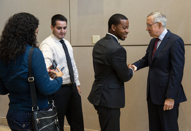 William McCurdy II, second from right, shakes hands with U.S. Sen. Harry Reid at University of Nevada Las Vegas Friday, May 30, 2014. Reid met with student leaders to discuss a Senate bill aimed t ...