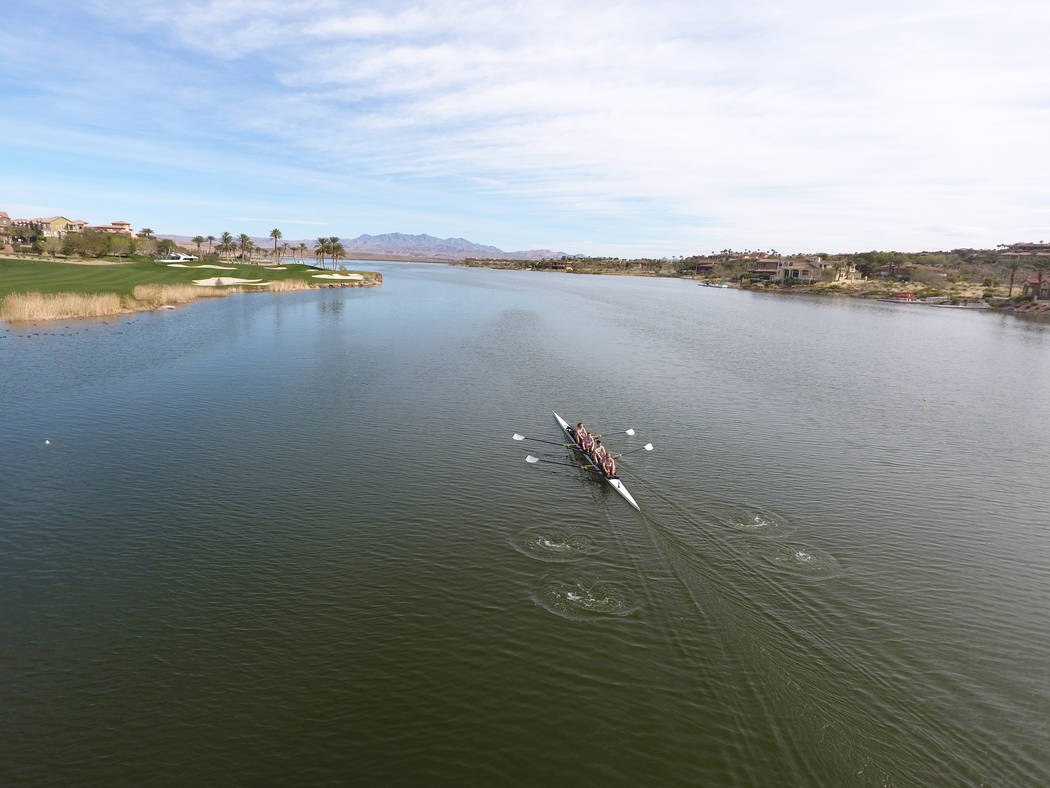 The University of Washington women's varsity 4+ rowing team makes their way to the starting point during the first Collegiate Invitational Rowing Regatta at Lake Las Vegas on Saturday, Marc ...