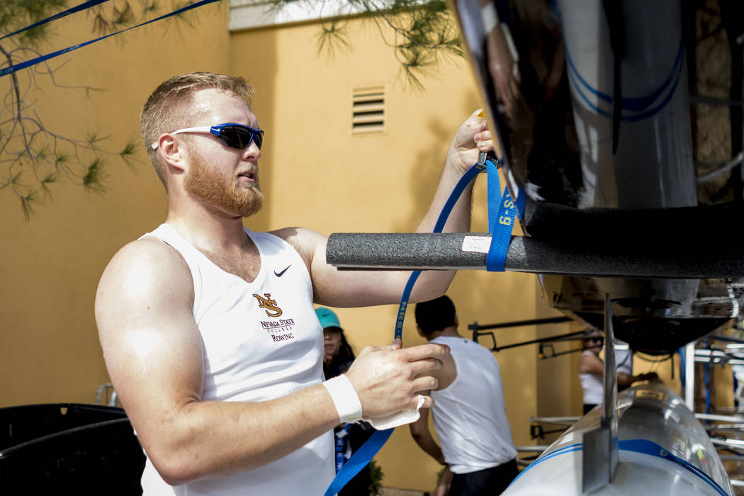Nevada State College rowing team member Daniel Champan secures the boat after competing in the Lake Las Vegas Collegiate Invitational, Sunday, March 5, 2017.  (Elizabeth Brumley/Las Vegas Review-J ...