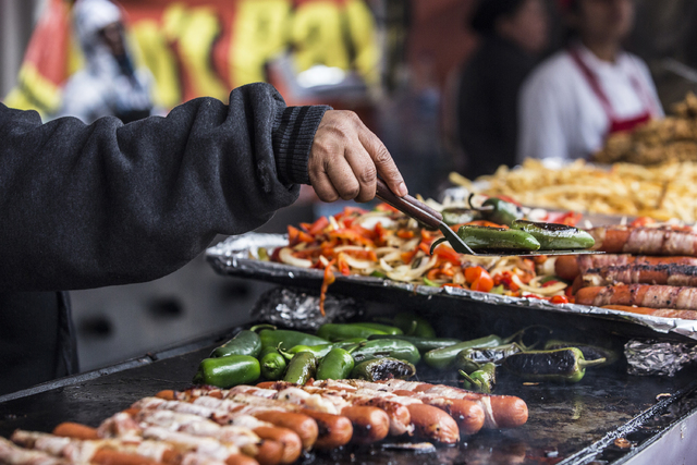 Grilled hot dogs with onions and peppers were a favorite at the 17th Annual Taste and Sound of Soul food and music festival on Saturday, Feb. 25, 2017, at the Fremont Street Experience, in Las Veg ...