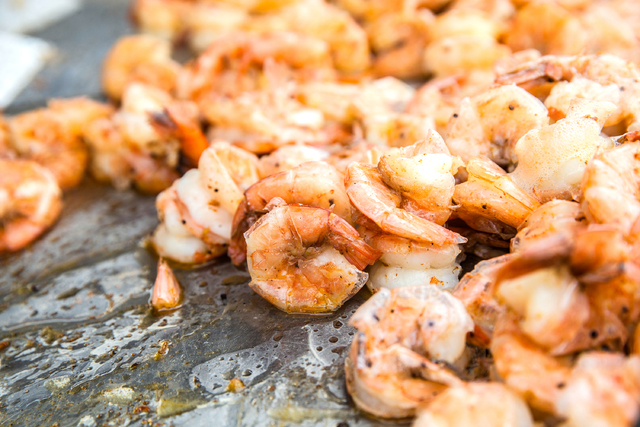 Buttered cajun shrimp cooks on the grill at T & T's during the 17th Annual Taste and Sound of Soul food and music festival on Saturday, Feb. 25, 2017, at the Fremont Street Experience, in Las  ...