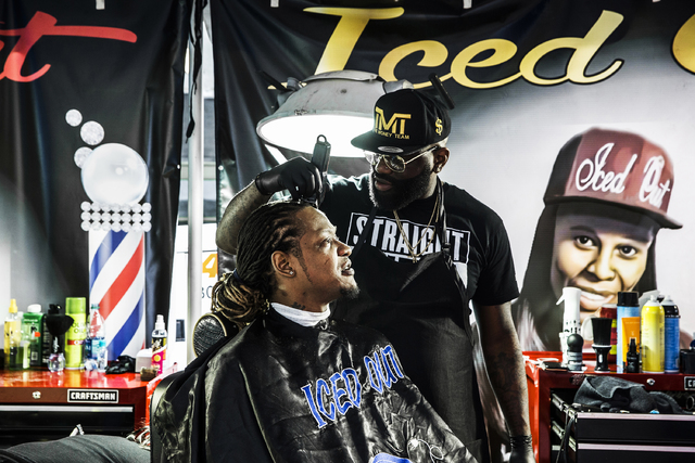 Michael Barnett, left, gets his hair cut by barber Phil Shelton at Iced Out Barber Shop's booth during the 17th Annual Taste and Sound of Soul food and music festival on Saturday, Feb. 25, 2017, a ...