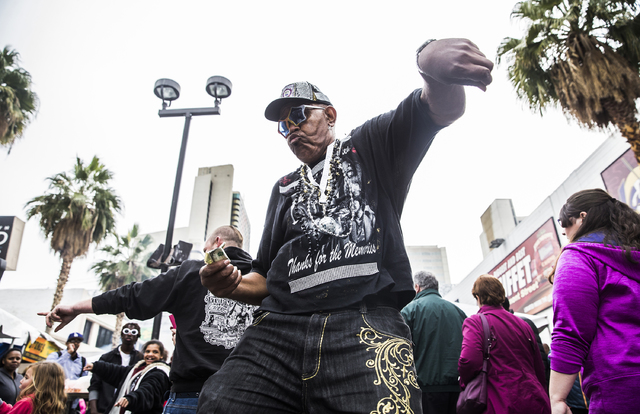 Sekou Kala dances on South 3rd Street during the 17th Annual Taste and Sound of Soul food and music festival on Saturday, Feb. 25, 2017, at the Fremont Street Experience, in Las Vegas. (Benjamin H ...