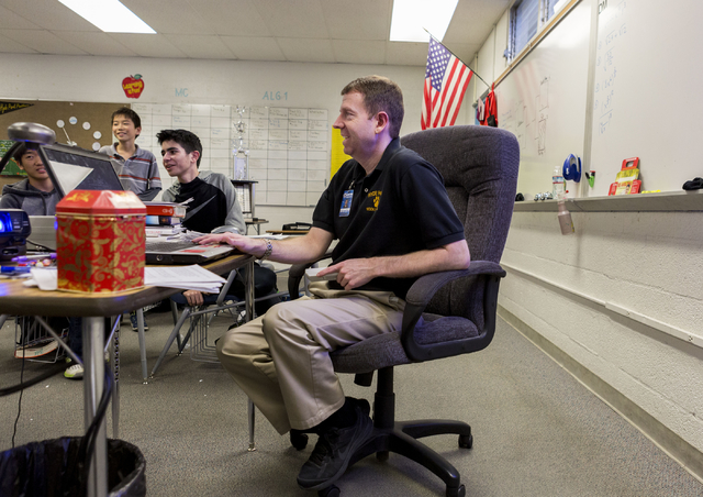 Brandon Lawrence, sixteenth year teaching algebra one and the MathCounts elective, runs math drills in preparation for southern Nevada MathCounts state competition, Hyde Park, Las Vegas, Feb. 21,  ...