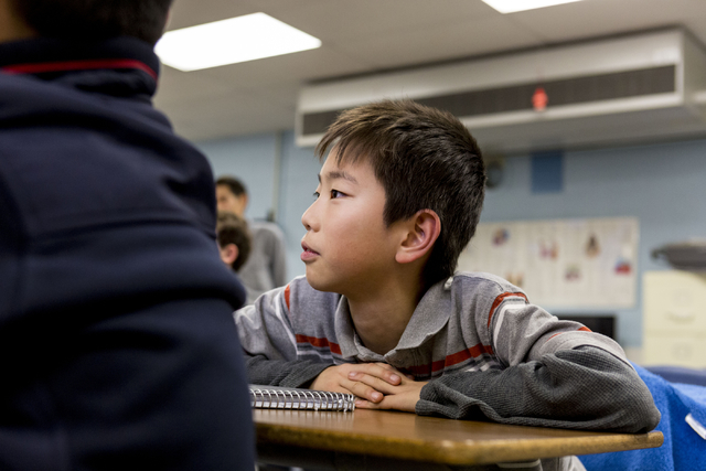 Raymond Zhang, 11, a member of MathCounts at Hyde Park Middle School, watches as his teammates practice math drills in preparation for southern Nevada MathCounts  state competition, Hyde Park, Las ...