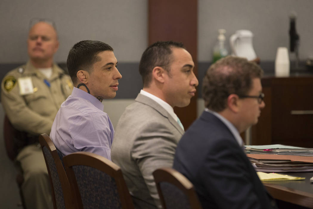War Machine, also known as Jon Koppenhaver, far left, appears at the Regional Justice Center next to defense attorneys Brandon Sua, center, and Jay Leiderman, right, on Monday, March 6, 2017, in L ...