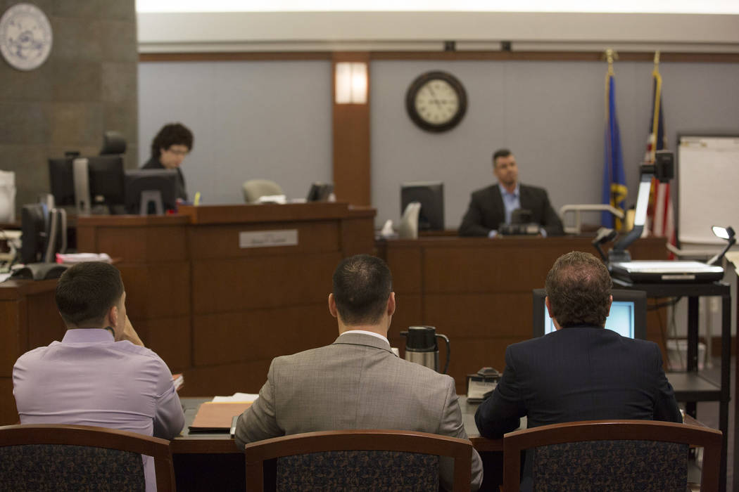 War Machine, also known as Jon Koppenhaver, left, sits next to defense attorneys Brandon Sua, center, and Jay Leiderman, right, at the Regional Justice Center on Monday, March 6, 2017, in Las Vega ...