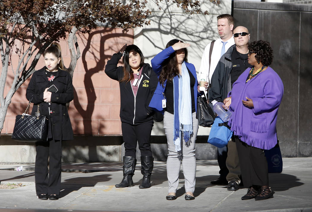 People wearing heavy jackets wait at red traffic light for crossing Casino Center Boulevard on sunny but cold Tuesday morning on March 7, 2017, in Las Vegas. (Bizuayehu Tesfaye/Las Vegas Review-Jo ...