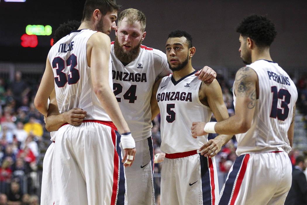 Gonzaga players, from left, Killian Tillie (33), Przemek Karnowski (24), Nigel Williams-Goss (5) and Josh Perkins (13) huddle during the West Coast Conference basketball championship game against  ...
