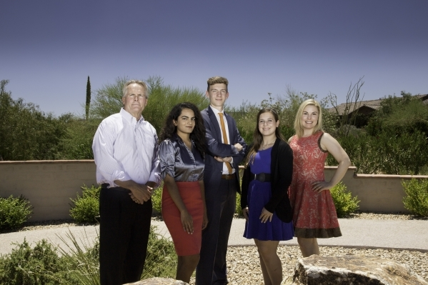 From left, are Randy Ecklund, vice president and executive director, Summerlin community management; 2015 Summerlin Children's Forum scholarship recipients, Abi Prabhu, Parker Johnson and Ro ...