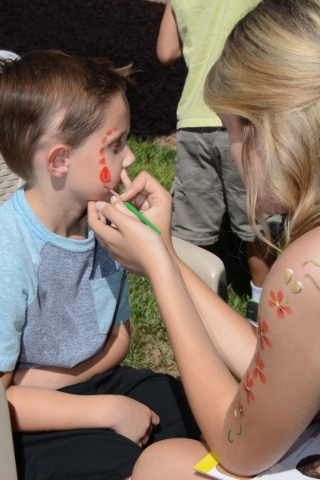 Kids can get their faces painted at  Sunday's grand opening of the Huckleberry Park in Providence. PROMOTIONAL PHOTO