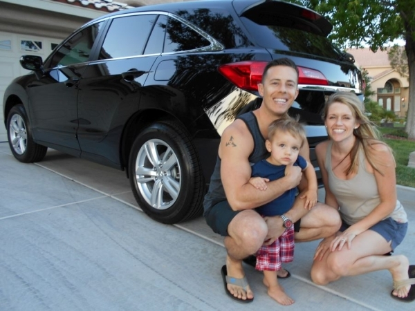 Shown with their Certified 2015 Acura RDX V6 are Jeff and Sharelle Henle and their 23-month old son, Lucas. The family purchased the vehicle from Findlay Acura in the Valley Automall. COURTESY