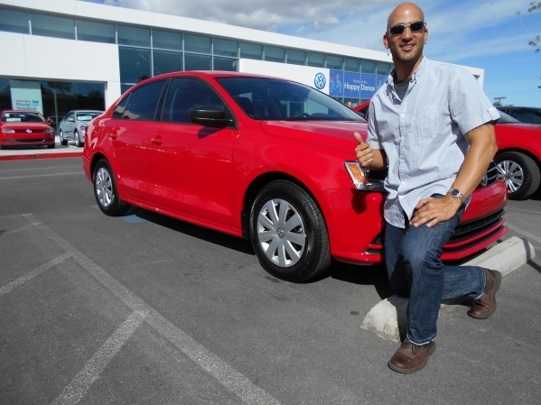 Nellis Air Force civilian Carlos Del Valle won a 2015 Volkswagen Jetta in the Ultimate Summer Sweepstakes giveaway. He is shown taking delivery of the vehicle at Findlay North Volkswagen at 7500 W ...