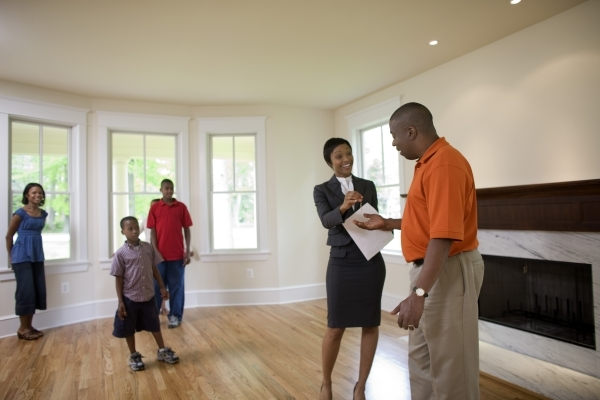 Realtor with family in new home