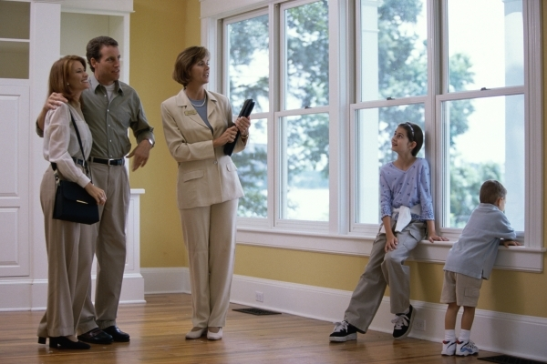 Estate agent showing a family a house