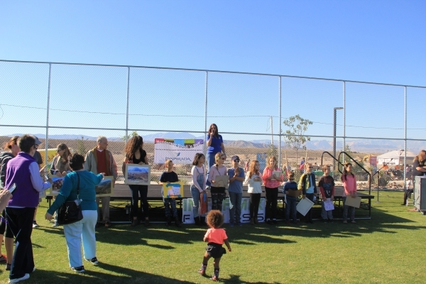 Henderson Councilwoman Debra March recognizes winners of the Rockin' Art of Sloan Canyon contest during the Stroll 'n Roll event at Inspirada that drew thousands of joggers, bikers and ...