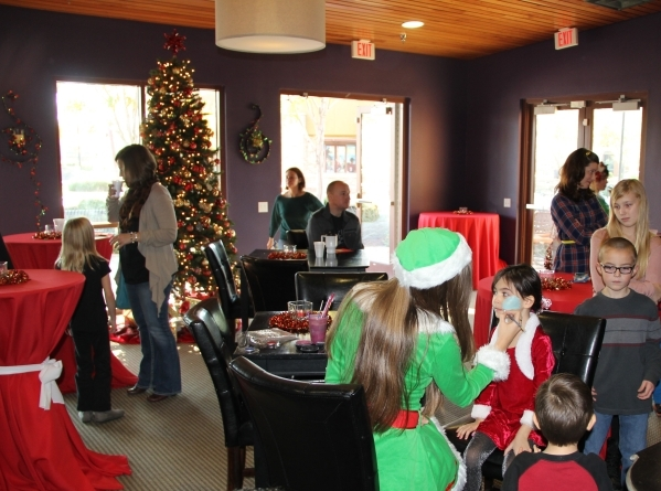 Inspirada residents enjoy refreshments during a recent holiday Mix, Mingle and Jingle event. Complimentary face-painting is always a popular attraction for the children. PROMOTIONAL