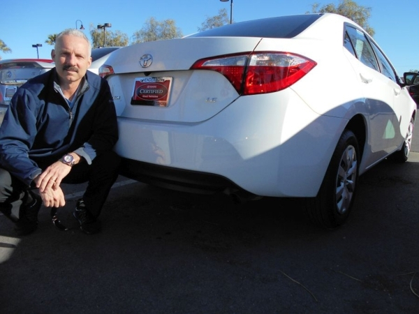 Findlay Toyota used car manager Rob Martin is seen with one of many Toyota Certified Used Car vehicles at the dealership in the Valley Automall. COURTESY