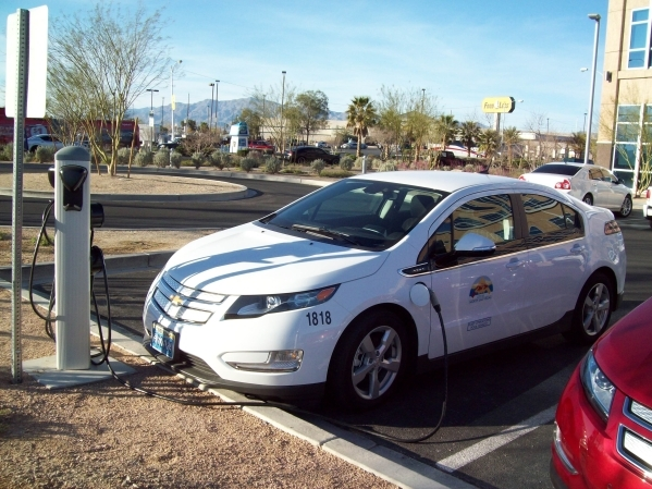 A Chevrolet Volt fleet vehicle for the city of North Las Vegas charges up its lithium-ion battery pack at a ChargePoint station in the parking lot of the City Hall building.   PHOTO BY STAN HANEL