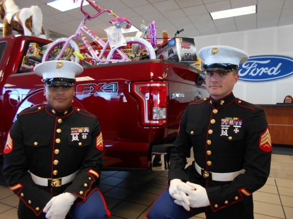 U.S. Marine Sgt. Kyle Abreu-Buendia, left, and Sgt. David Johnson, both members of Second Battalion 23rd Marine Regiment Fox Company Weapons Platoon, stopped by Friendly Ford to pick up Christmas  ...