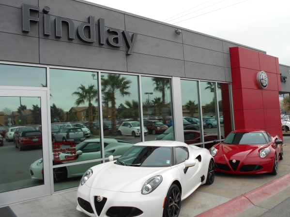 Findlay Fiat Alfa Romeo in the Valley Automall has experienced a fever pitch of buyers wanting the Alfa Romeo model. Shown, from left, are the 2016 Alfa Romeo 4C Coupe and the 2015 4C Alfa Romeo C ...