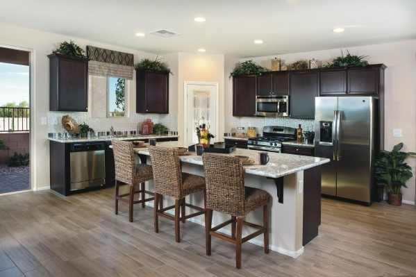 Kitchen and island seating area featured at  the Hillcrest model home at Shadow Pointe. PROMOTIONAL