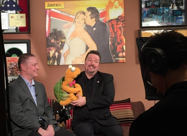 Findlay Automotive Group CFO Tyler Corder, left, and celebrity impressionist Terry Fator kicked off the annual iChoose to Drive campaign sponsored by Findlay Automotive Group and Cox Media. COURTESY