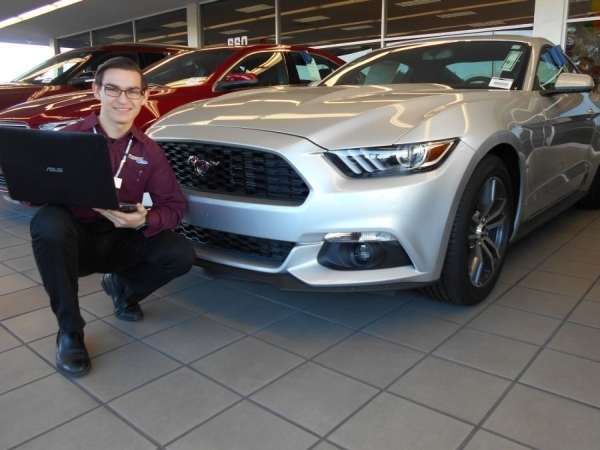 Friendly Ford business development coordinator Ryan Gura poses with a 2016 Mustang Coupe at Friendly Ford at 660 N. Decatur Blvd. COURTESY