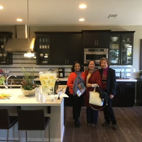 Stopping by for refreshments in Pardee Home's Alterra kitchen, Realty One Group real estate professionals, from left, Lali Chemplavil, Norma Gutin and Sue Kamjorn, were guests at Inspirada&l ...