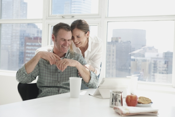 Happy Middle-aged couple using digital tablet THINKSTOCK