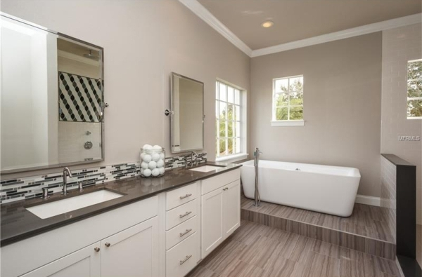 "Photo courtesy of Jill Thomson of Jill Thomson DesignGrey tones and 12 x 24"" tiles in this master bathroom designed by Jill Thomson bring a contemporary look to the space."