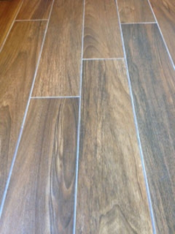 Courtesy of Sun West Custom Homes  Wood-look tile floors offer the durability of tile but the style of hardwood floors.