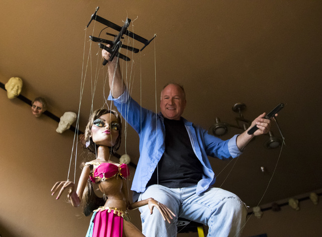Scott Land, master puppeteer and owner of Team Land Productions, manipulates a marionette at his company's warehouse in Las Vegas on Wednesday, Feb. 1, 2017. (Miranda Alam/Las Vegas Review-Journal ...