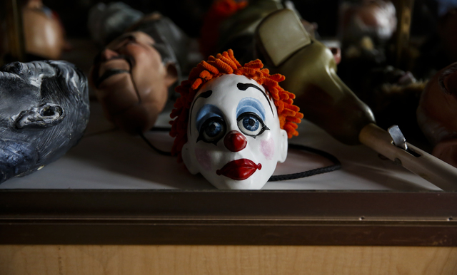 A clown marionette head sits in a glass case at Team Land Productions in Las Vegas on Wednesday, Feb. 1, 2017. (Miranda Alam/Las Vegas Review-Journal) @miranda_alam